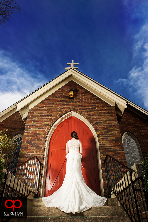 Epic bride in front of a church,