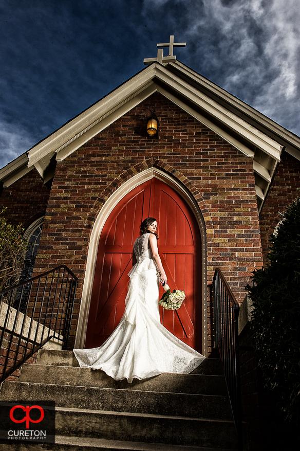 High fashion bride on church steps.