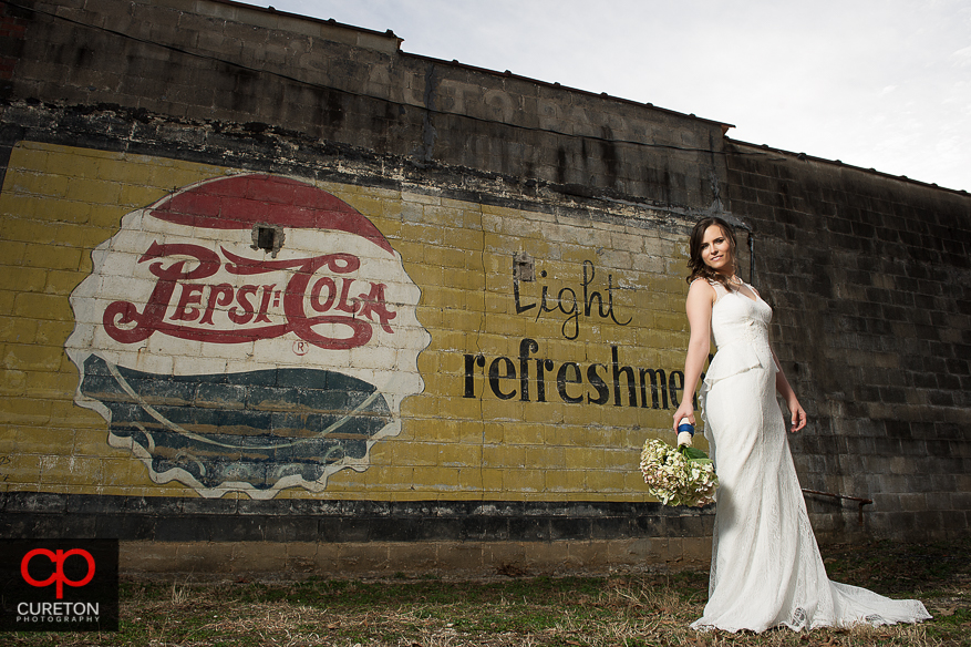 Bride with Pepsi sign.