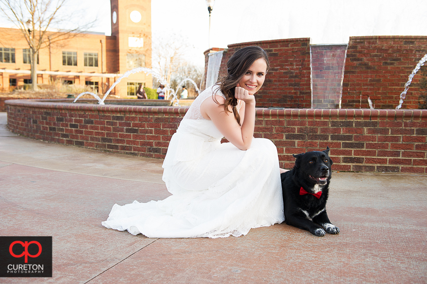Bride and dog at fountain.