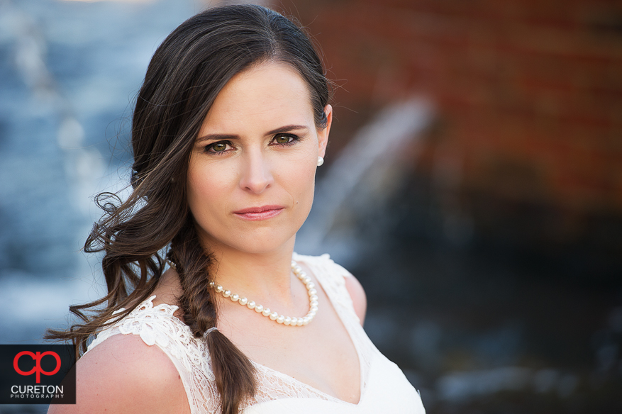 Bride and fountain closeup.