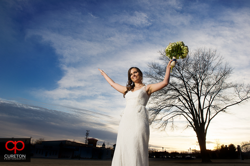 Bride with hands in the air.