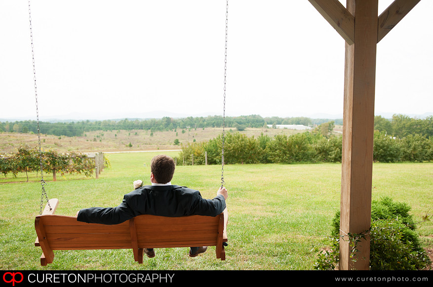Groom hanging out on a bench overlooking the SC mountains before his wedding.
