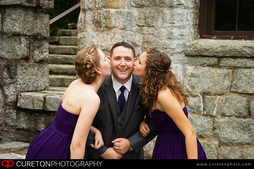 A groom and his daughters share a moment before his wedding.
