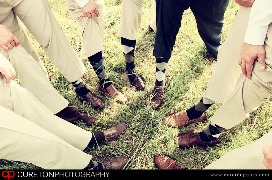 Groomsmen showing off their socks.