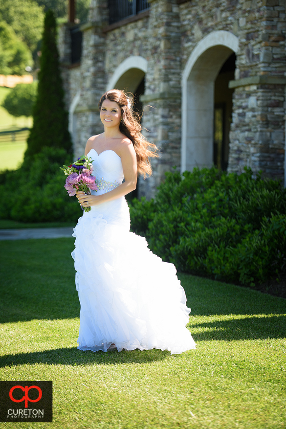 Bride standing in front of the lodge at Grand Highlands at Bearwallow Mountain.