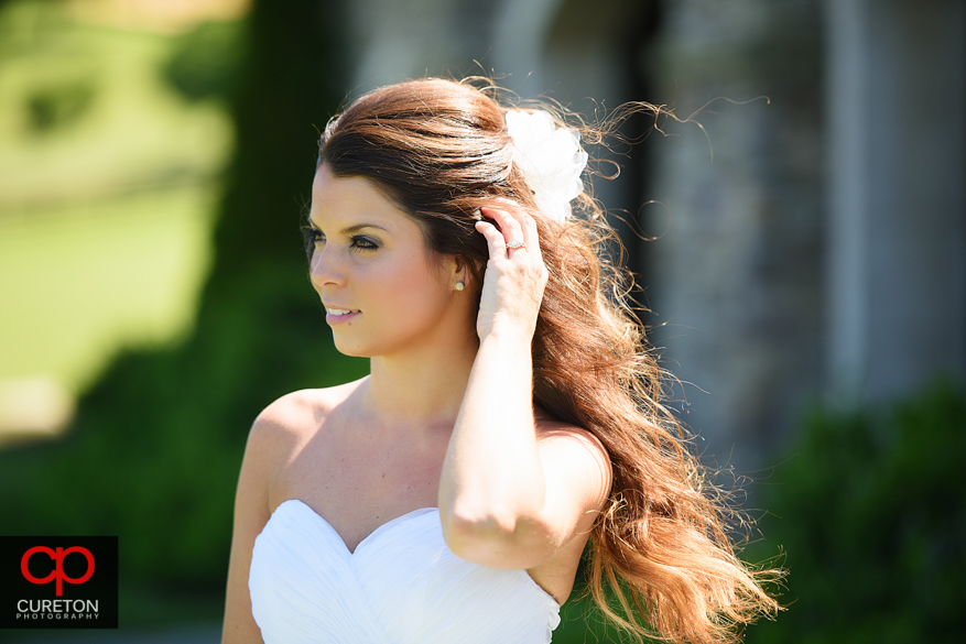 Bride with her hair in the wind during a bridal session at Grand Highlands.