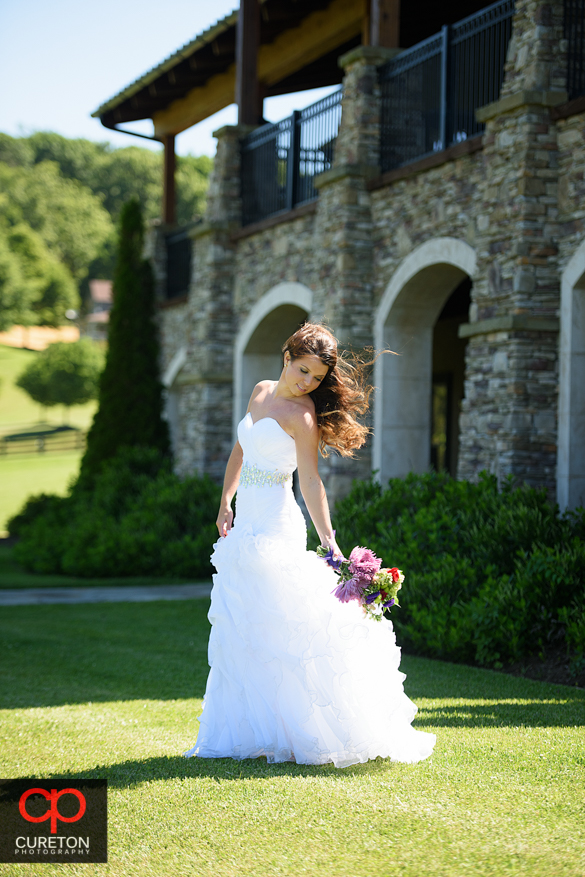 Bride holding her bouquet down during a Hendersonville, NC bridal session.