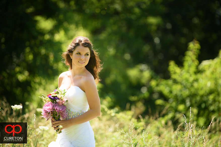 Bride in gorgeous sunlight at Grand Highlands.