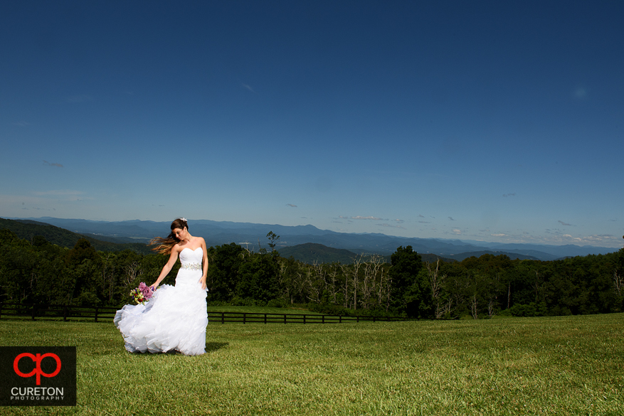 Bride with mountains behind her at Grand Highlands at Beawallow Mountain.