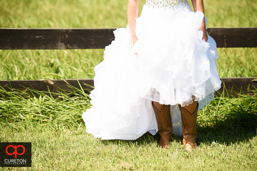 Bride showing her cowboy boots.