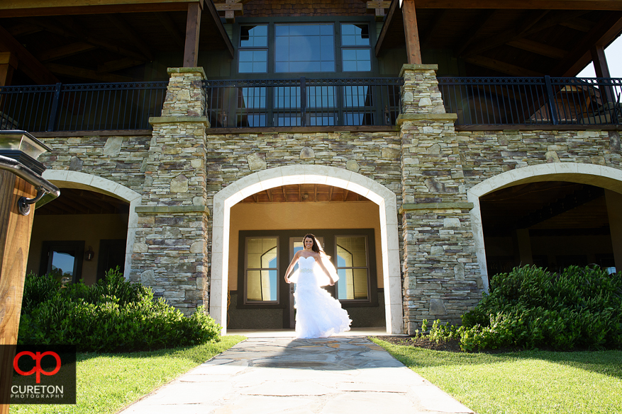 Bride standin in front of the clubhouse at Grand Highlands at Bearwallow Mountain.