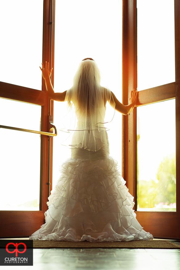 Bride opening double doors.