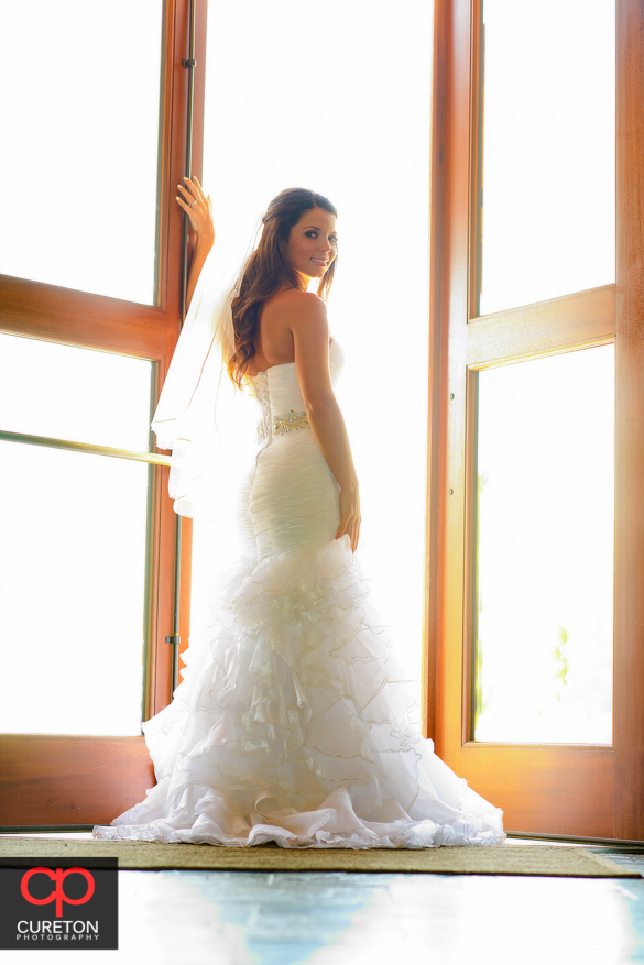 Bride walking out of the clubhouse at Grand Highlands at Bearwallow mountain before her wedding.