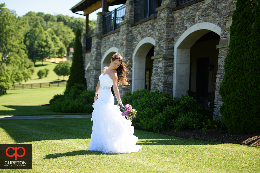 Bride with her hair blowing in the wind during a Hendersonville, NC bridal session.
