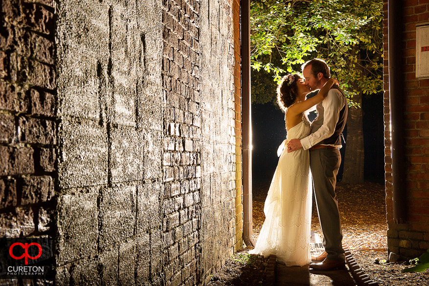 A couple kissing outside their Huguenot Loft Wedding in downtown Greenville,SC.