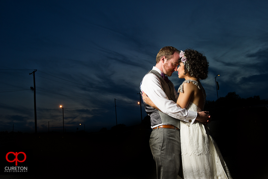 Couple at sunset after their Huguenot Loft Wedding in downtown Greenville,SC.