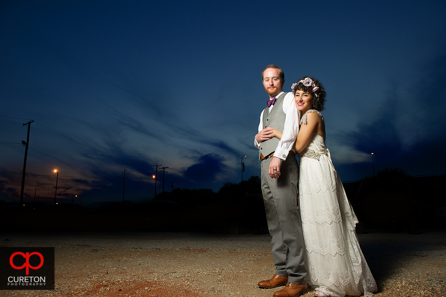 Couple hugging at sunset after their Huguenot Loft Wedding in downtown Greenville,SC.