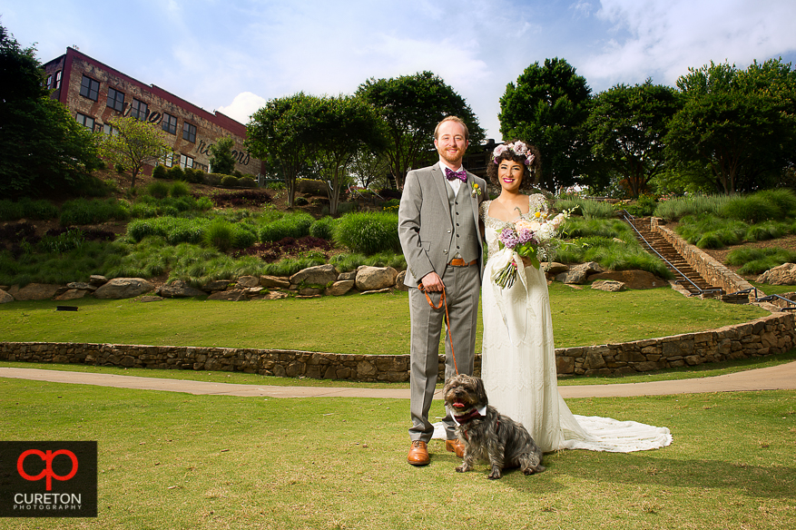 Couple and their dog in Falls Park before their wedding.