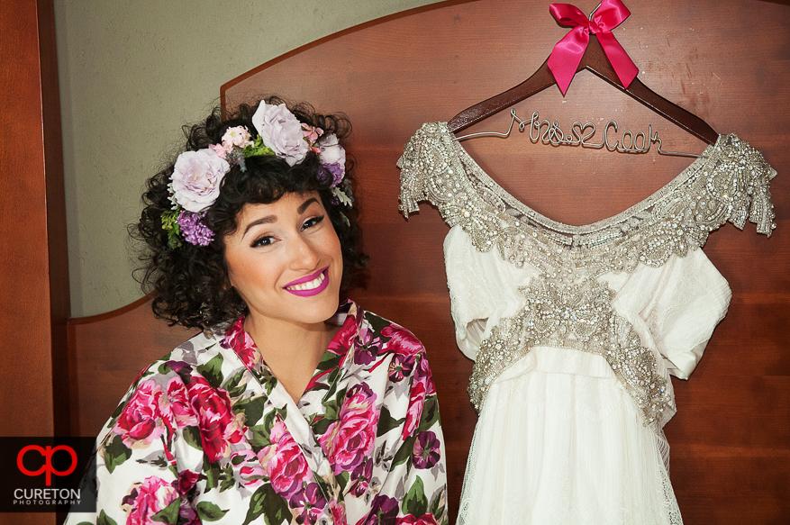 Bride posing with dress in downtown Hampton Inn.