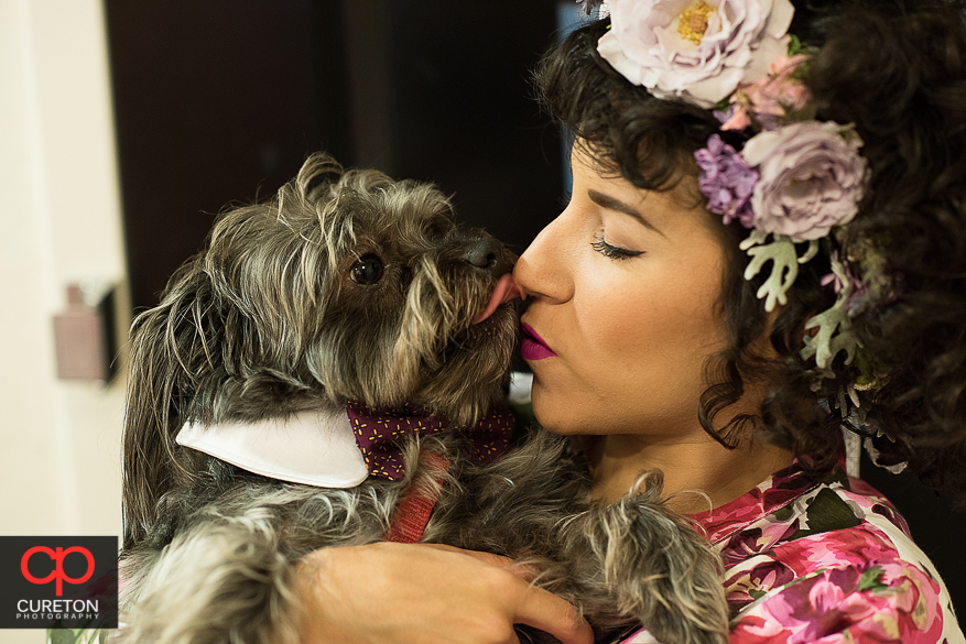 Bride posing with her dog.