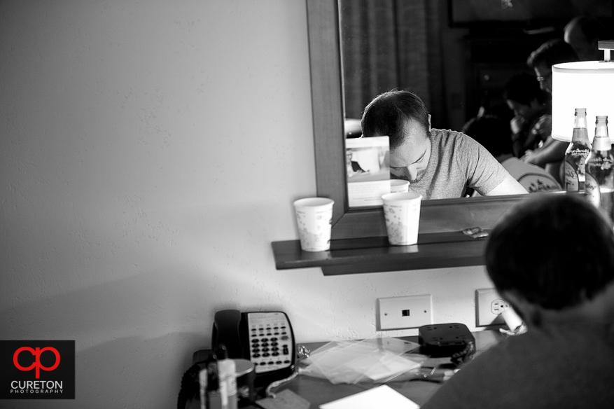 Groom writing letters to his groomsmen.
