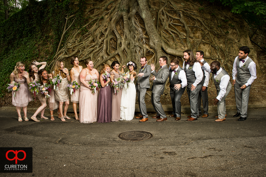 Creative wedding party photo at Falls Park in downtown Greenville.
