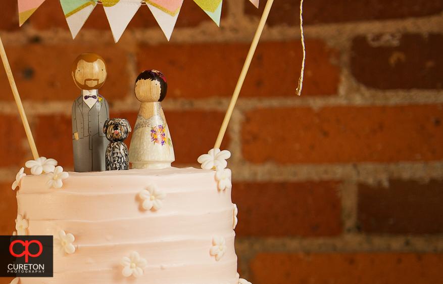 Cute custom wedding cake toppers.