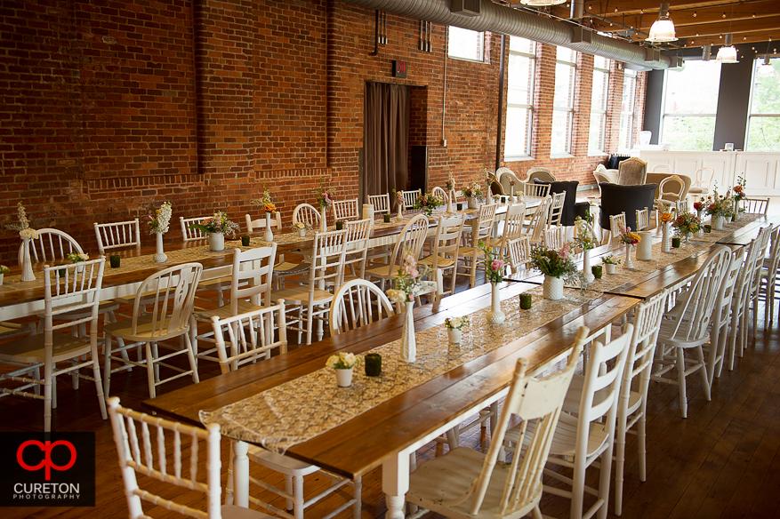 Farmhouse tables setup for the wedding reception.