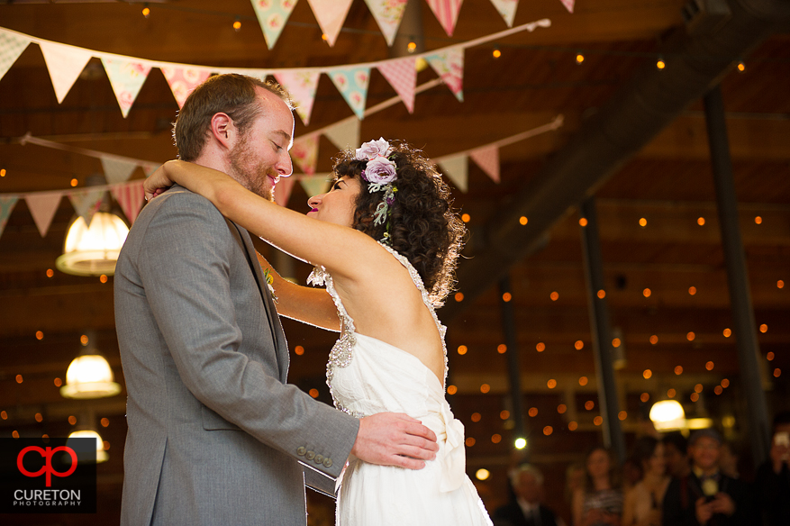 Couple haing their first dance as a married couple.
