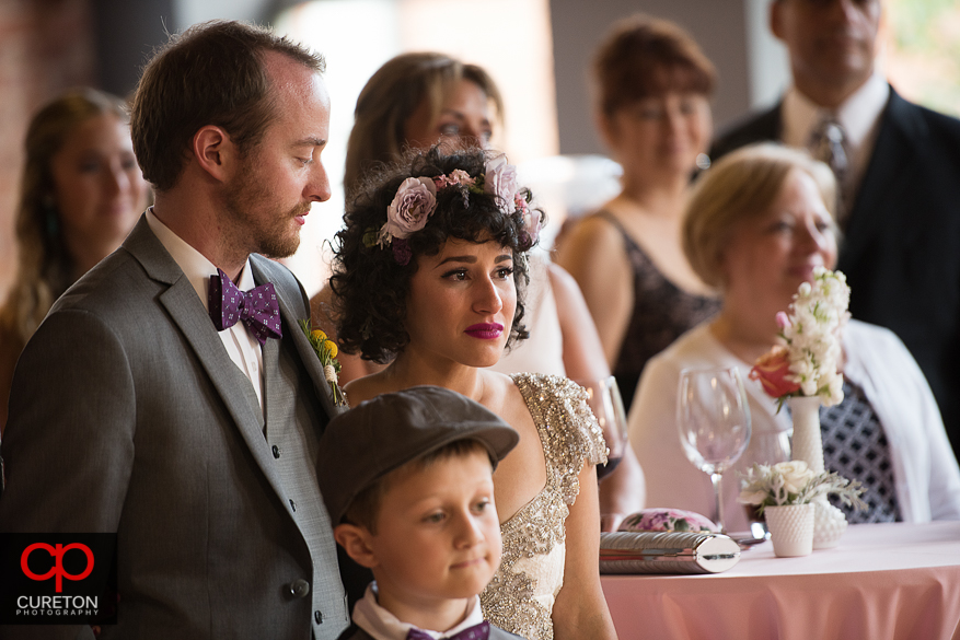 Bride cries at her father's speech.
