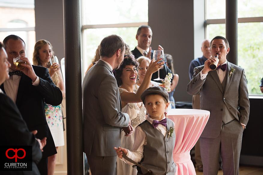 Bride and groom raise a toast.