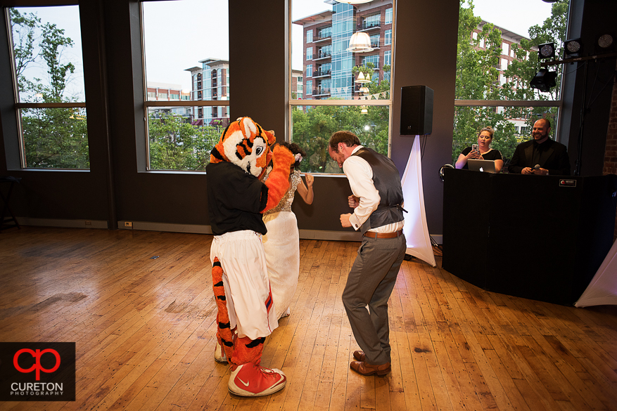 Couple dancing with the Clemson tiger at the wedding reception.