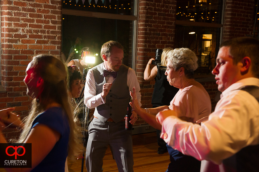 Guests dancing as Uptown Entertainment plays the wedding reception at Certus Loft.