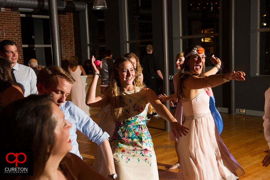 Guests dance at the Huguenot Loft wedding reception in downtown Greenville,SC.