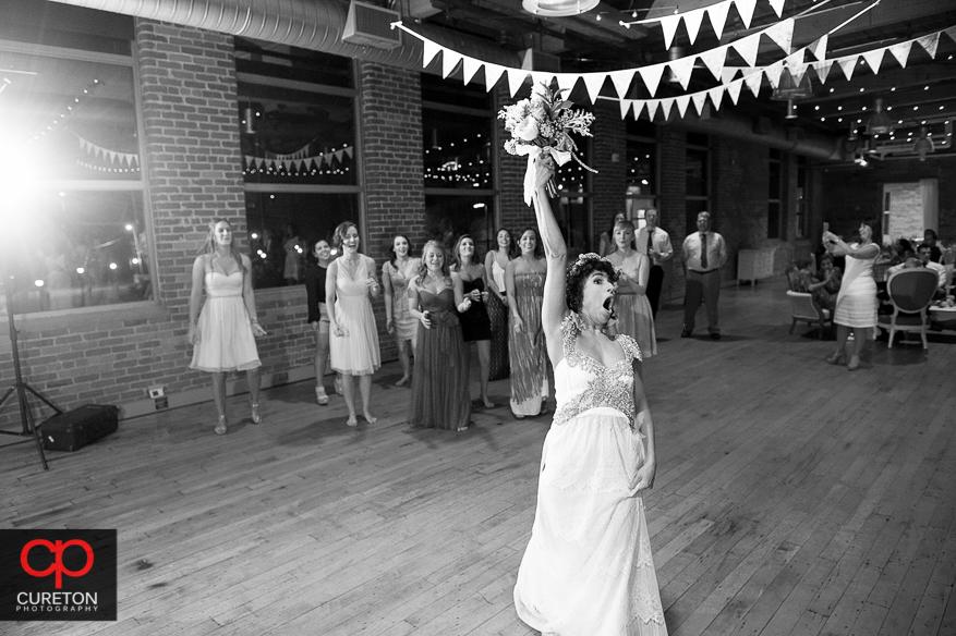 Bride tossing her bouquet .
