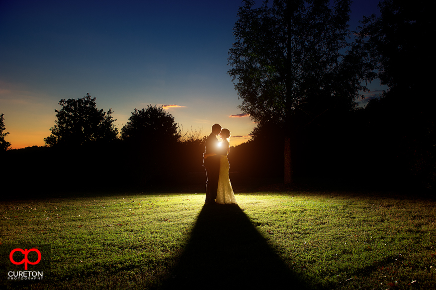 Bride and groom during sunset at Lenora's Legacy.