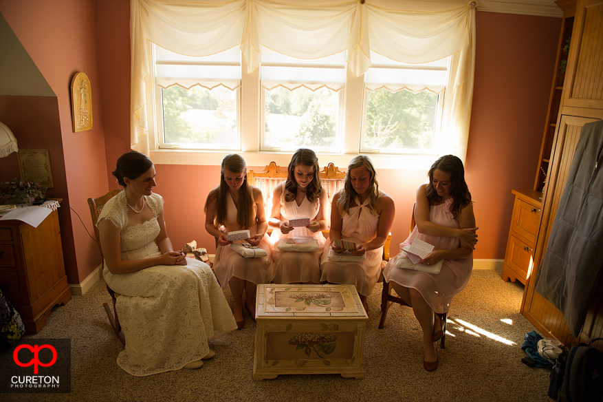 Bride giving bridesmaids gifts.