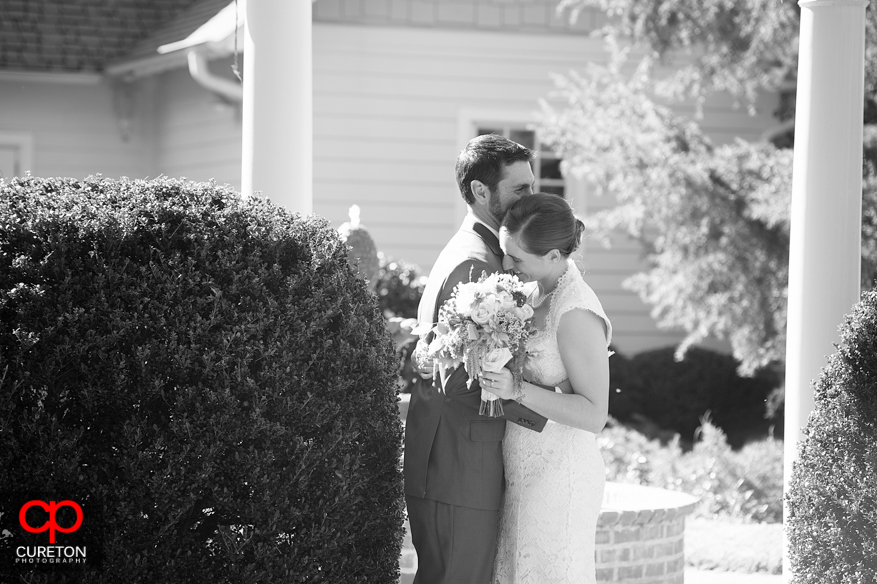 Black and white of bride and groom's first look.