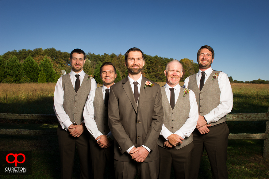 Groomsmen in the field.