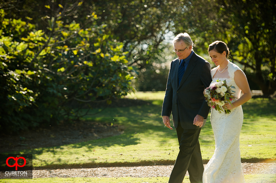 Ftehr walks his daughter down the aisle at Lenora's Legacy.