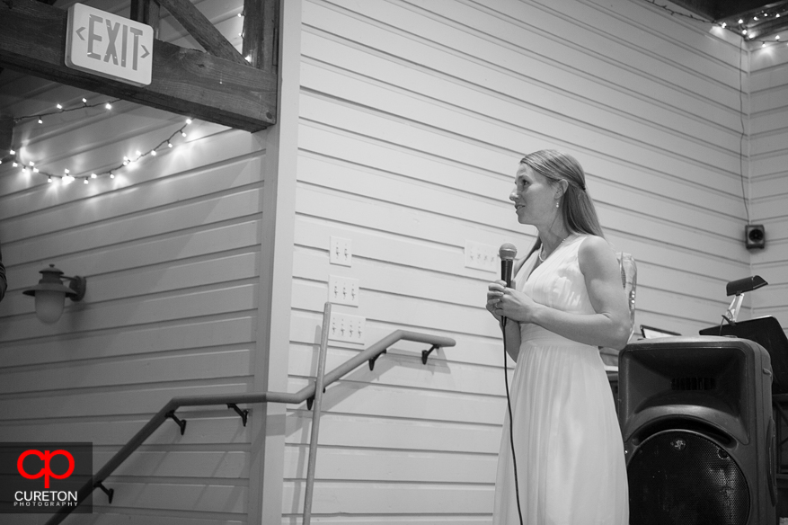 The matron of honor gives a heartfelt toast.