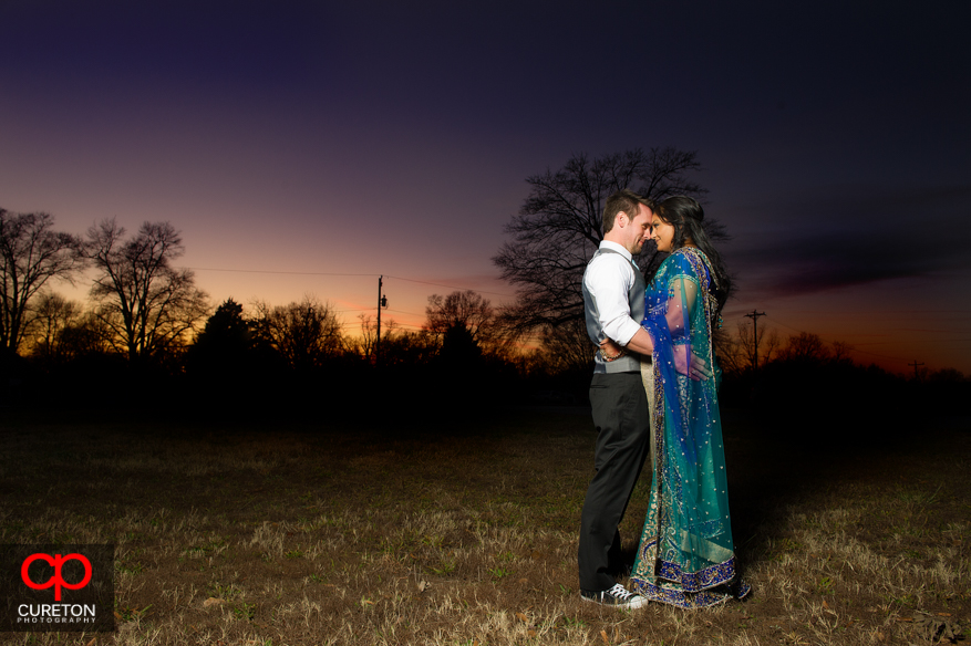 Bride and Groom at sunset with amazing sky colors.
