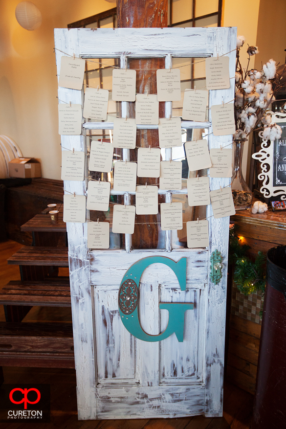 Old door used at wedding as seating map.