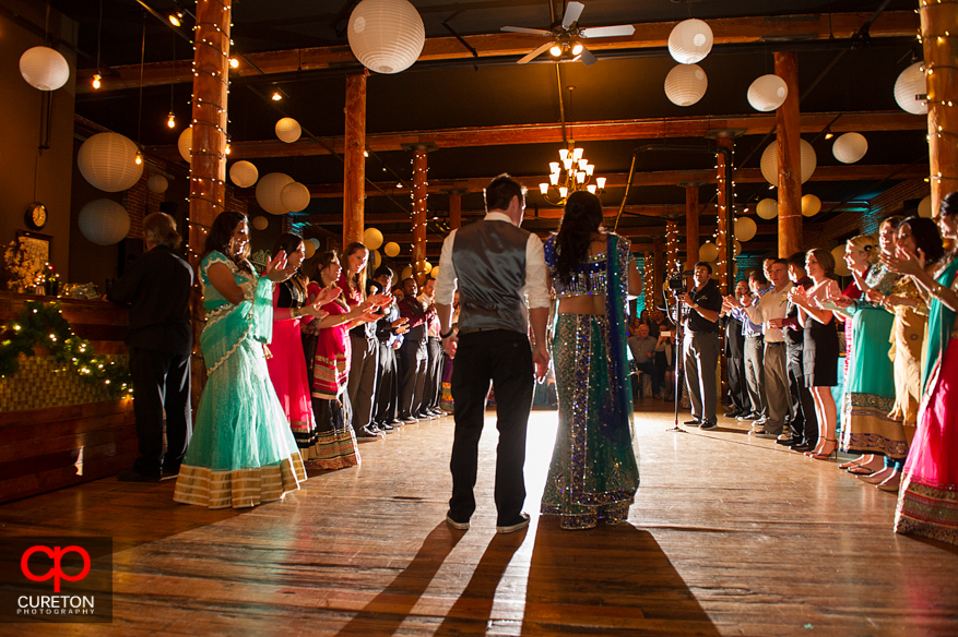 Bride and Groom make their entrance at their Indian wedding reception at The Loom in Simpsonville,SC.