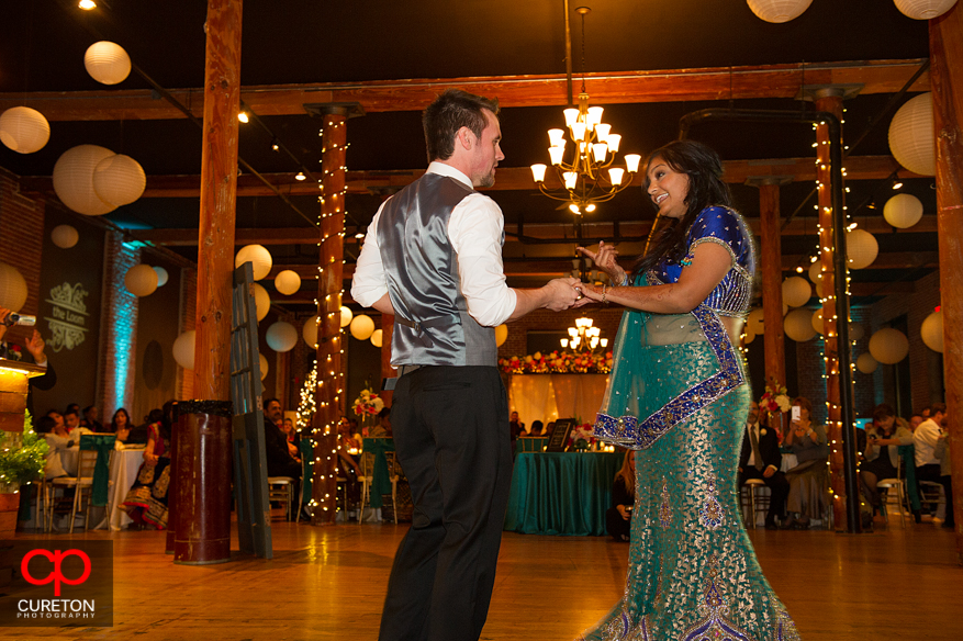 Couple dancing their first dance at their wedding reception.
