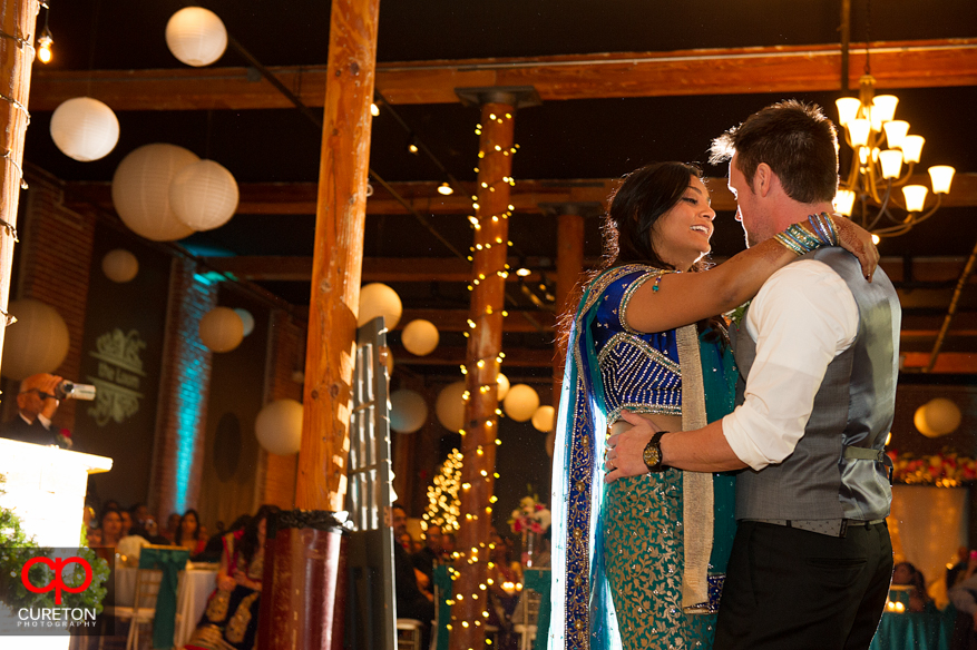 Bride looks at Groom during a dance at their Indian wedding reception.