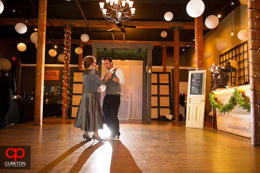 Groom and mother dancing at The Loom.