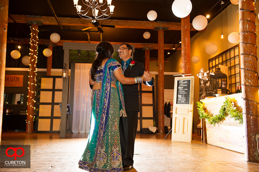 Bride and father dance at her Indian wedding reception.