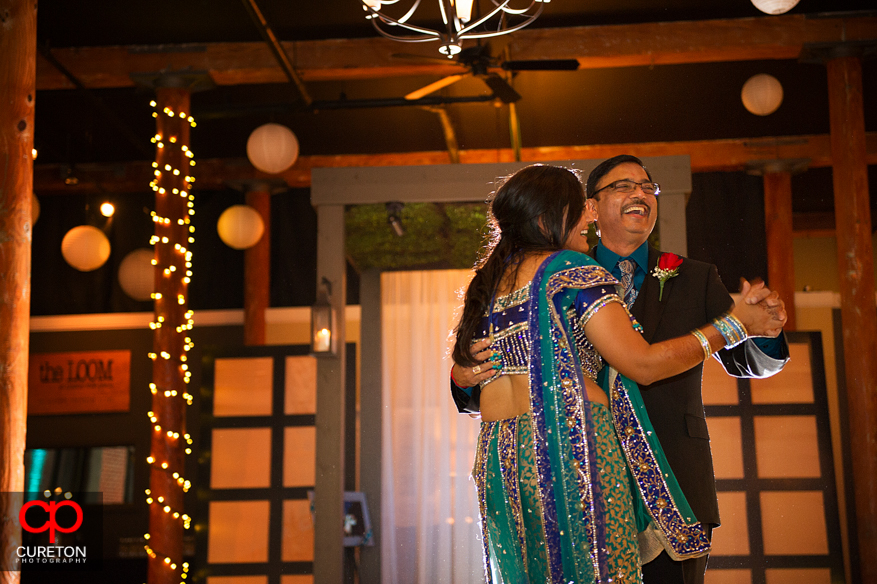 Dad laughing during father-daughter dance at the reception.